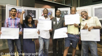 The winning photographers with their cheques