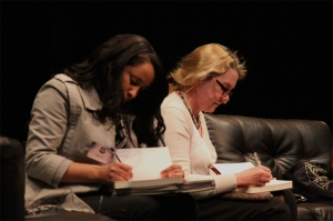 Carol-Ann davids and Claire Robertson sign copies of their books for fans. Photo: Pheladi Sethusa