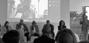 Pre-recorded videos and live-streams from the other provinces were projected onto the wall behind the panel. From left to right: Khadija Patel, DJ Fresh, Kagiso Lediga, Shaka Sisulu and facilitator Tumelo Mothotoane. Photo: Pheladi Sethusa