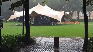 The South Arican Union of Jewish Students (SAUJUS) have erected what they call a peace tent on the library lawns. Not much foot traffic under the tent today on account of the rain. Photo: Pheladi Sethusa