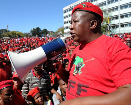 Economic Freedom Fighters leader Julius Malema is seen addressing supporters during a march to the SABC's head office in Johannesburg on Tuesday, 29 April 2014 over its refusal to air an Economic Freedom Fighters' television election commercial. Picture: Werner Beukes/SAPA