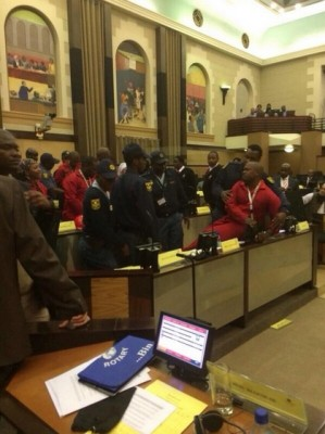 EFF MPs are removed by police from the Gauteng Provincial Legislature for wearing red overalls, 1 July 2014. Picture: @EconFreedomZA via Twitter