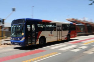 FILE PICTURE: A Rea Vaya bus passes its terminal. Picture: Alaister Russell.