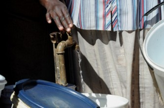 FILE PICTURE: A resident fills her bucket with water from a tap. Picture: Werner Beukes/SAPA