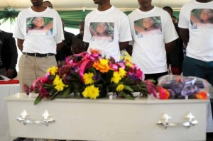 Mourners with images of murdered Veronicah Mofokeng on their t-shirts stand in front of her coffin during funeral proceedings in Soshunguve, 18 October 2014. Picture: Refilwe Modise